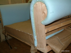 re-upholstery Arm being built up with first foam layer.