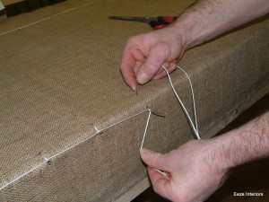 upholstered Sprung base being tied in and secured.