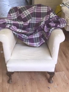 Old solid wing chair